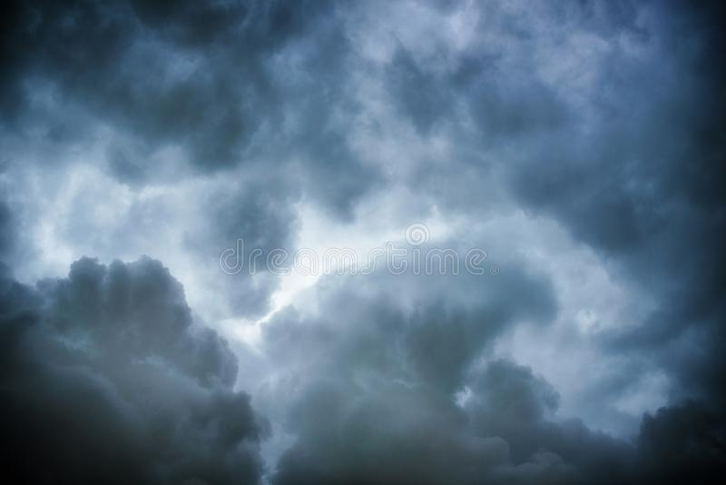 Black cloud and thunderstorm before rainy, Dramatic black clouds and dark sky royalty free stock image