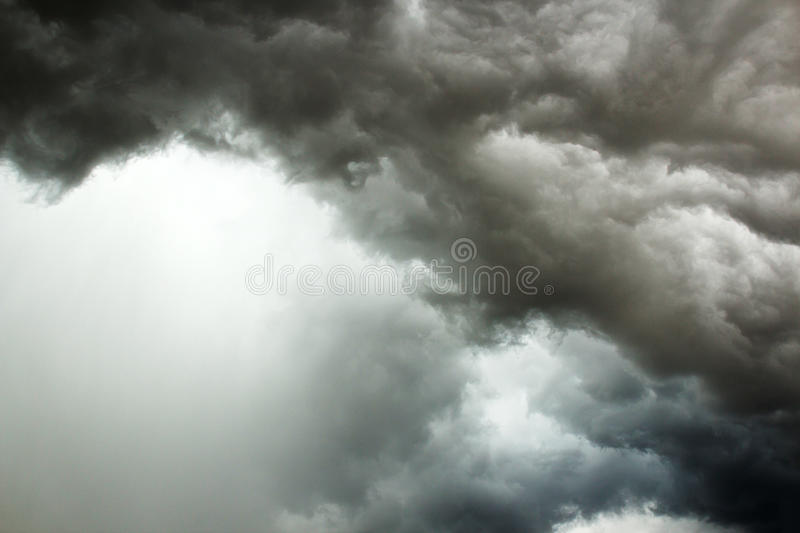 Black cloud in to the storm. Dark clouds, rain storms are forming stock image