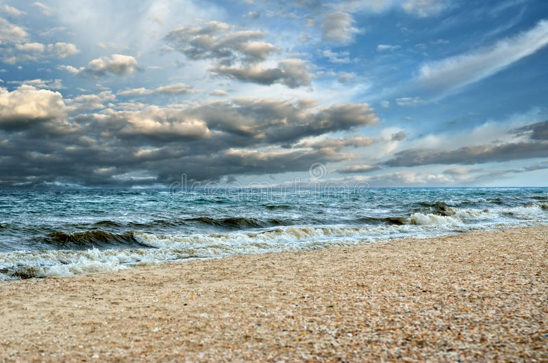 Black clouds and big waves, storm at sea. Strong winds during a hurricane in the open sea.  stock image