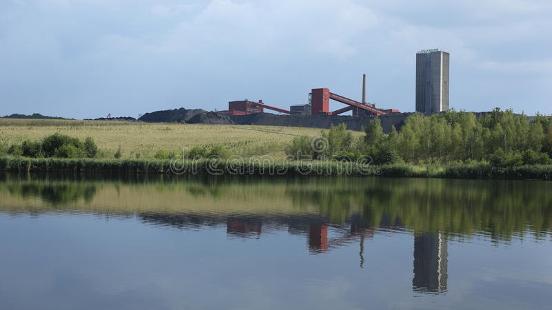 ORLOVA LAZY, CZECH REPUBLIC, AUGUST 12, 2015: Black coal mine, reclaimed surface coal mining with pond. Black coal mine, reclaimed surface coal mining with pond stock images