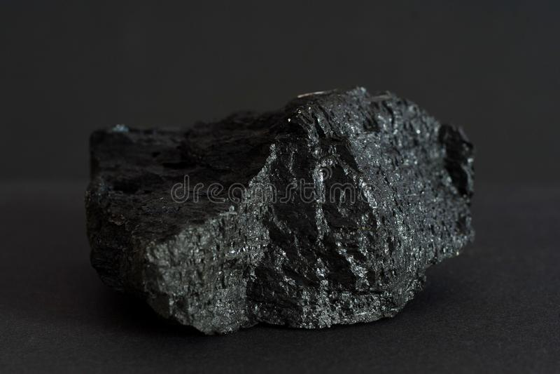 Black coal mineral on black background stock photo