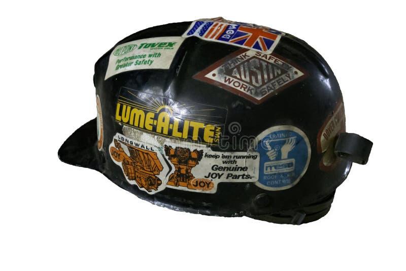 Black coal mining hard hat cerca 1980s royalty free stock photography