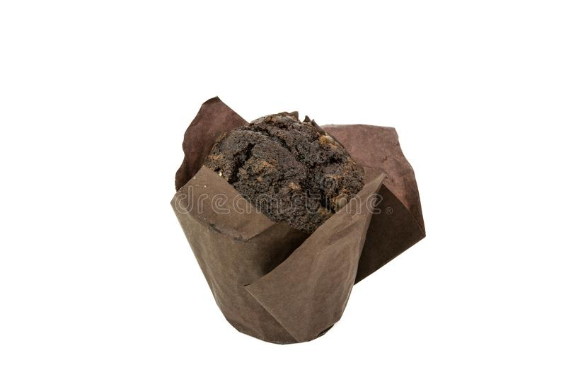 Black Cocoa Muffin With Chocolate Chips On It Closeup Isolated. On White Background royalty free stock image