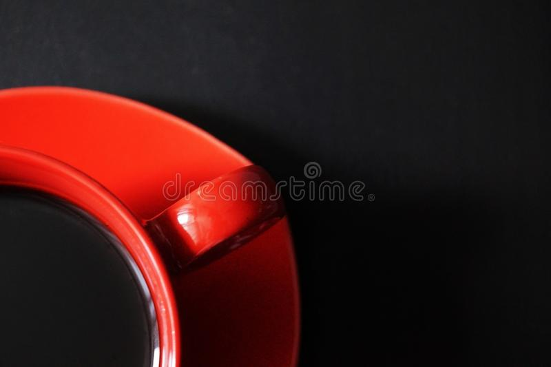 Black coffe in a red cup stock image