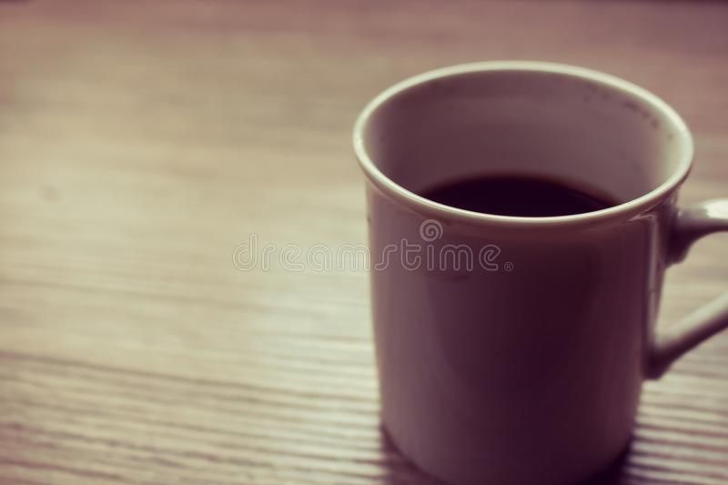 Black coffe on the wood table royalty free stock images