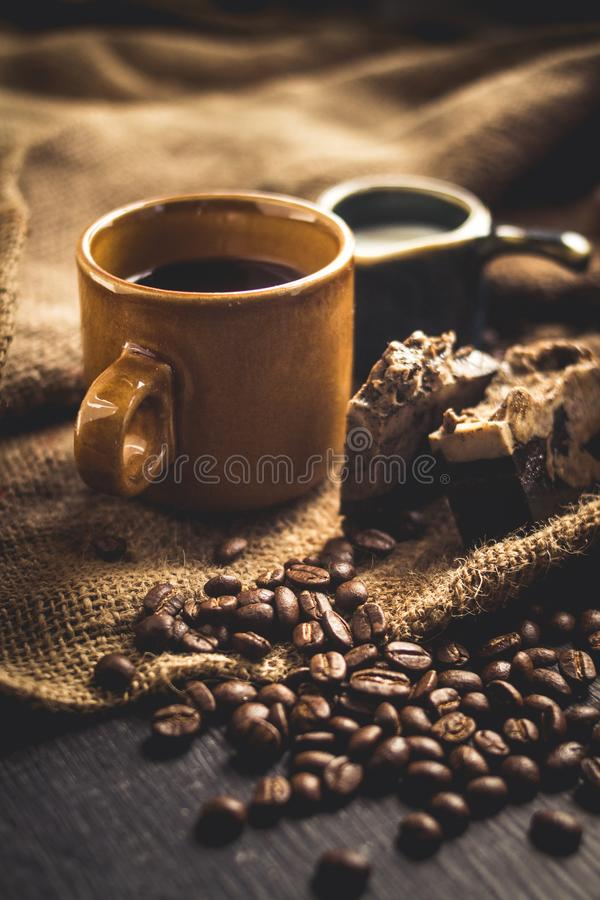Download Black Coffee Arabica In Brown Glass And Milk And Dessert Sack Background In Low Light Area Stock Image - Image of wooden, sack: 108855359