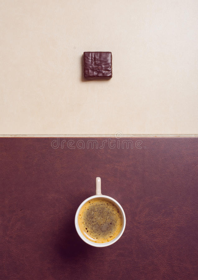 Black coffee with chocolate candies royalty free stock photos
