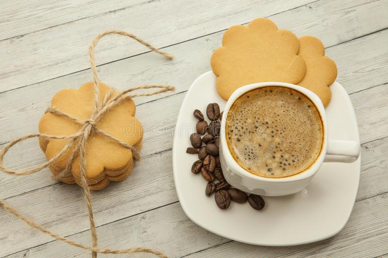 Black coffee with coffee beans and biscuits on a wooden background, good morning concept royalty free stock photos
