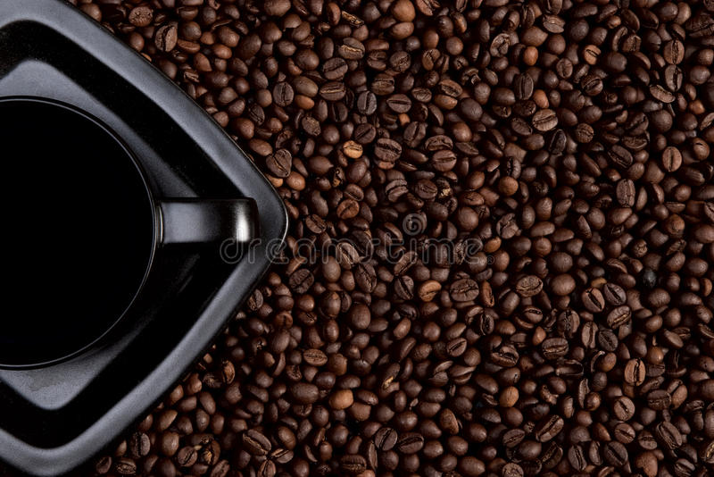 Black coffee cup on coffee beans. (coffee background royalty free stock photos