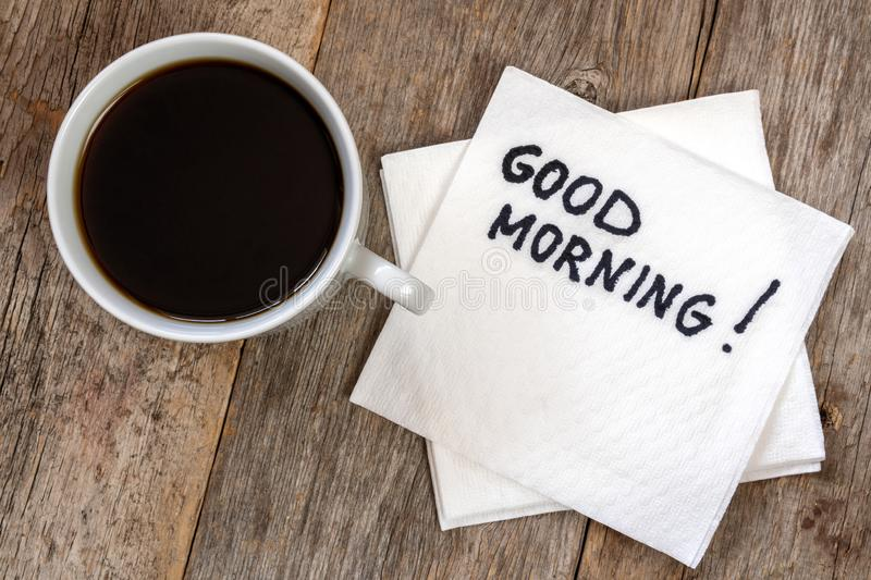 Good morning with coffee. Black coffee cup with good morning note on napkin royalty free stock images