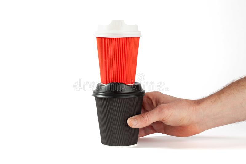 Black coffee cup with red coffee cup on top. stock photo