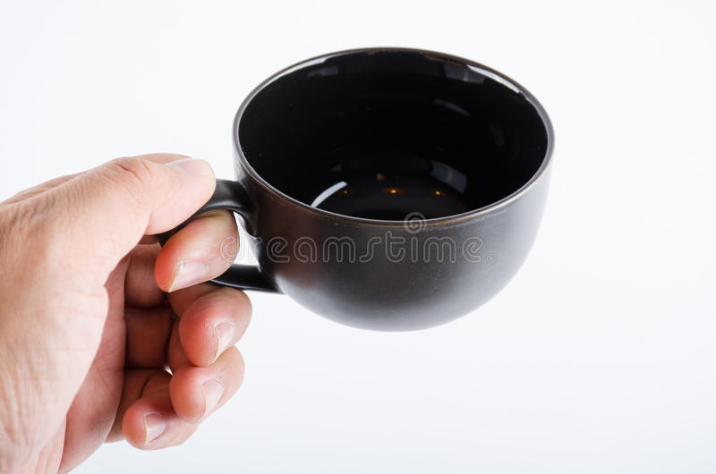 Black coffee cup on white stock image