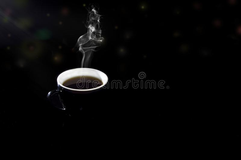 Black coffee in a dark glass on a black background royalty free stock image