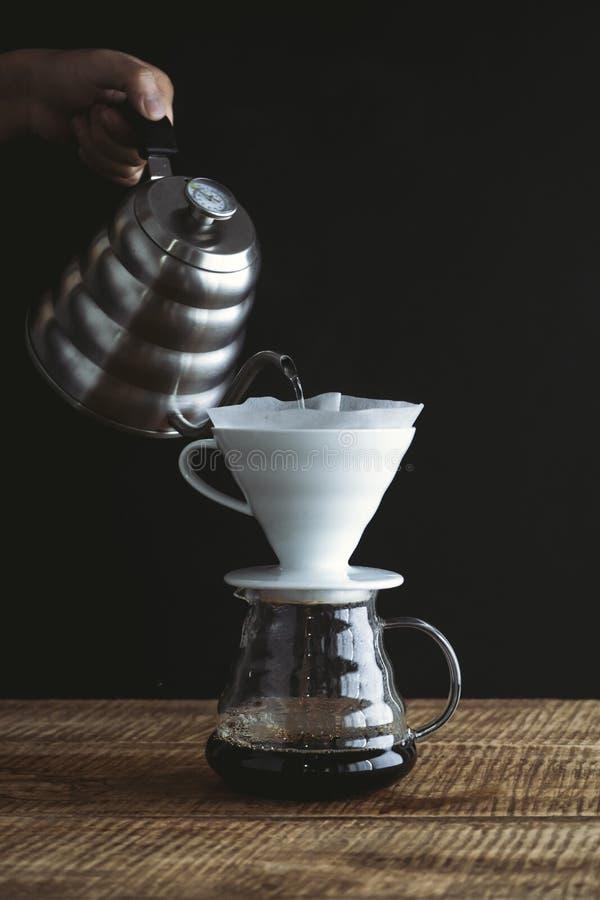 Black coffee drip On the wood Dark tone royalty free stock image