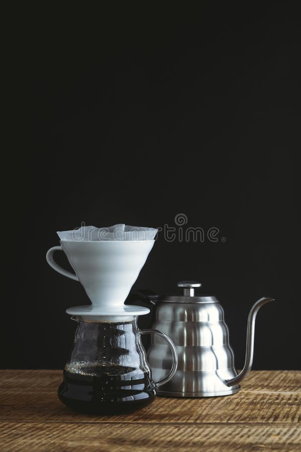 Black coffee drip On the wood Dark tone stock images