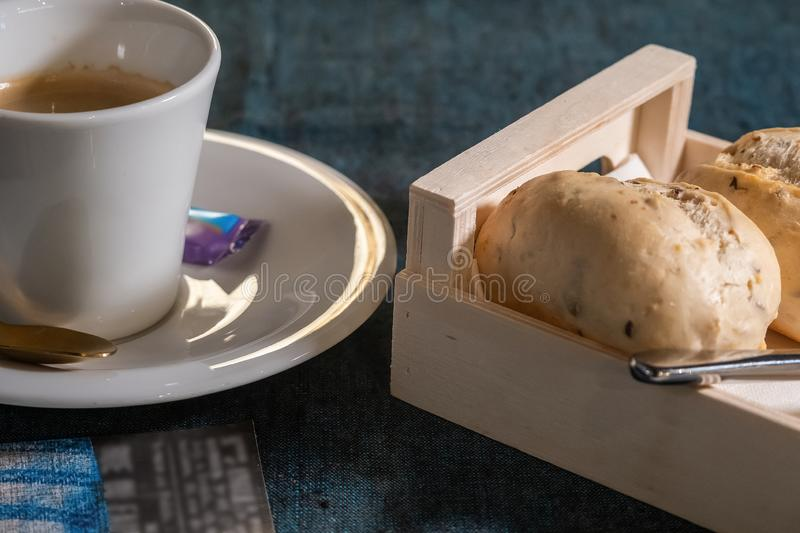 Black Coffee and fresh pastries. Light breakfast in the early morning stock images