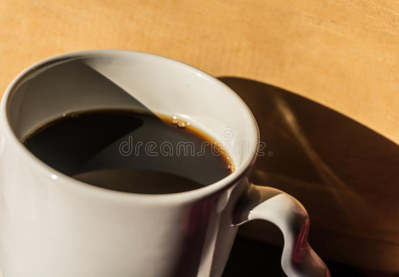 Black coffee on green note book. Morning drink and croissants stock photos