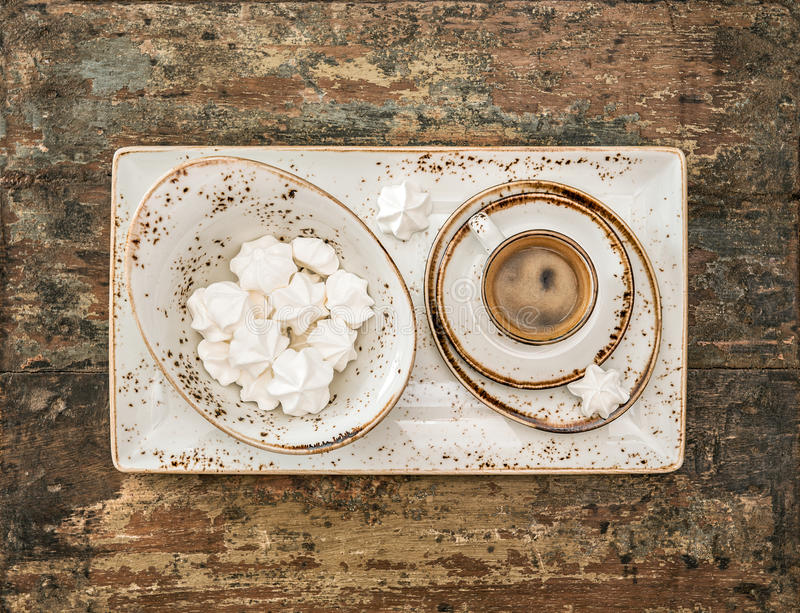 Black coffee with meringue cookies. Retro style still life. Top view royalty free stock photos
