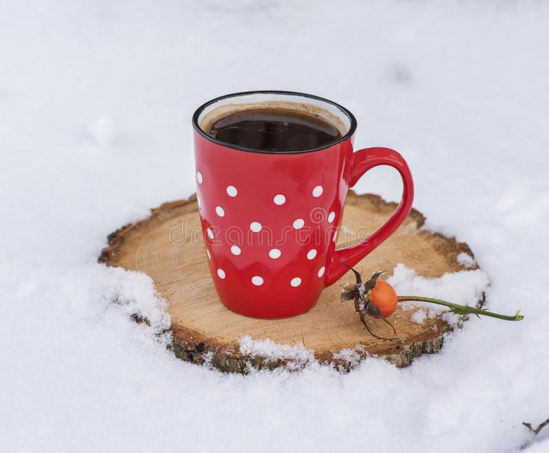Black coffee in a red ceramic mug in a white polka-dot stock photography