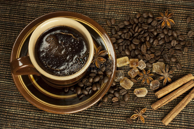 Black coffee with spices stock photos