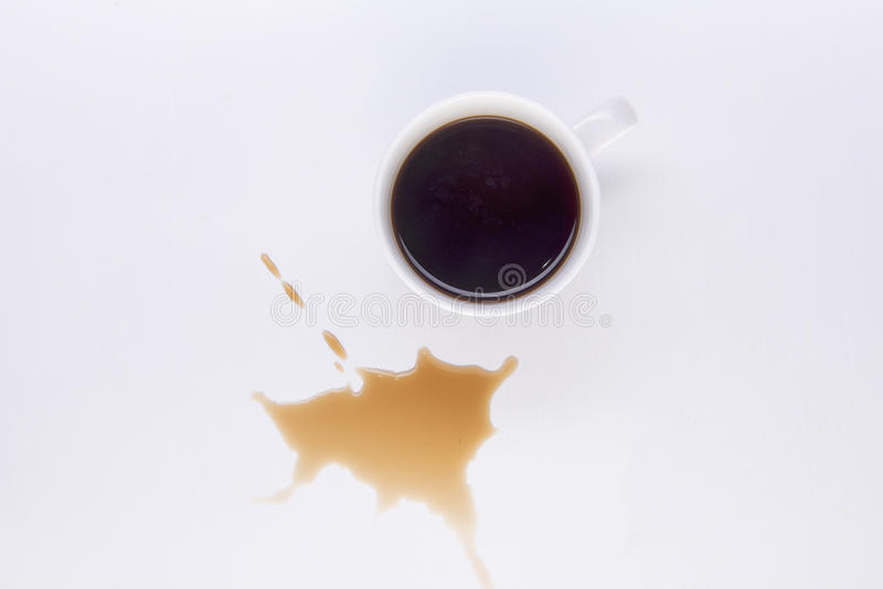Black coffee spill. On a white surface royalty free stock image