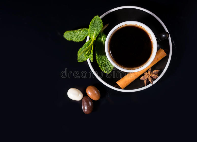 Black Coffee and Trio of Chocolate Covered Beans royalty free stock image