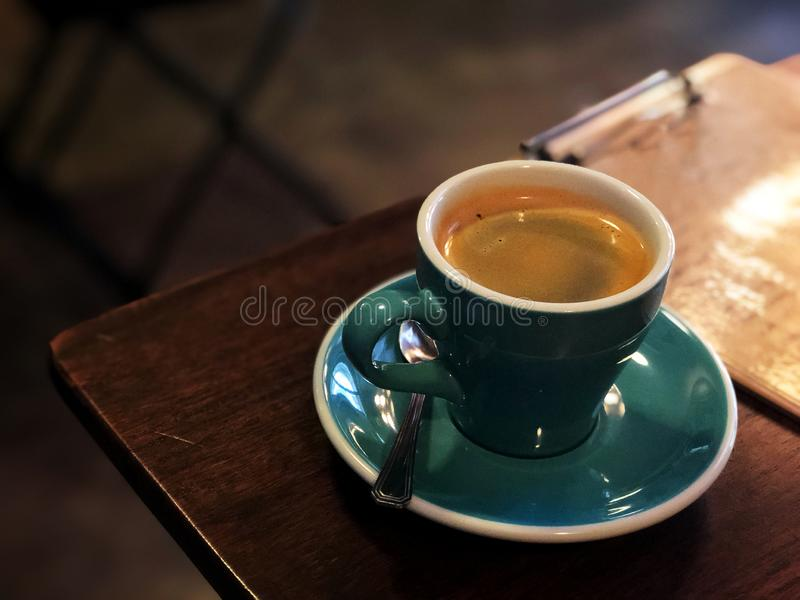 Black coffee Wake me up, Black coffee in white and green cup on the wooden table. Hot america-no , love coffee royalty free stock images