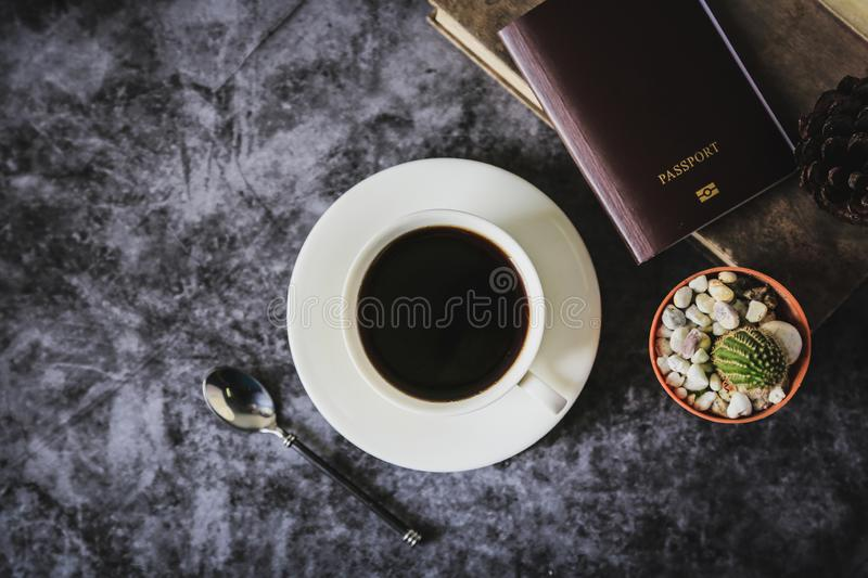 Black coffee in a white coffee cup and cactus placed on a black background stock images
