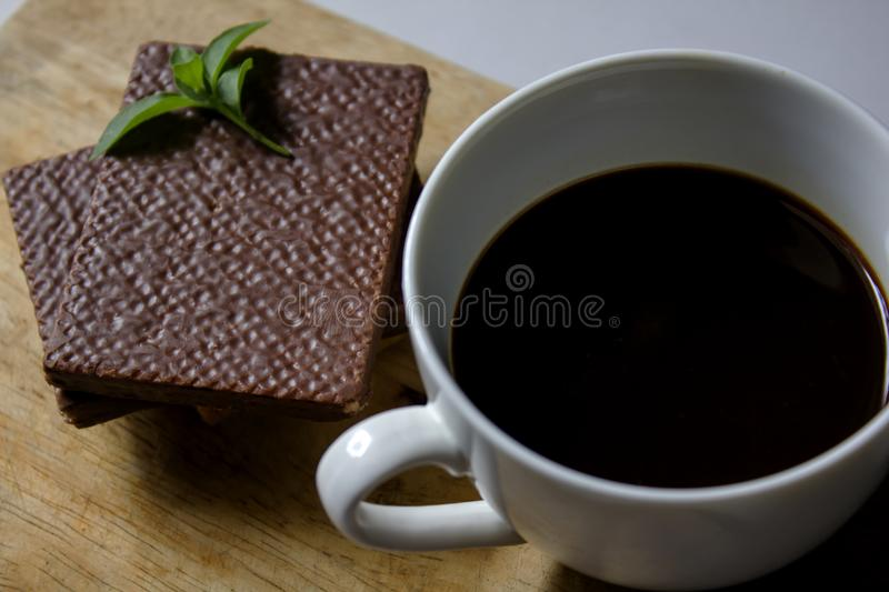 Black coffee in white glass and Wafer chocolate stock images