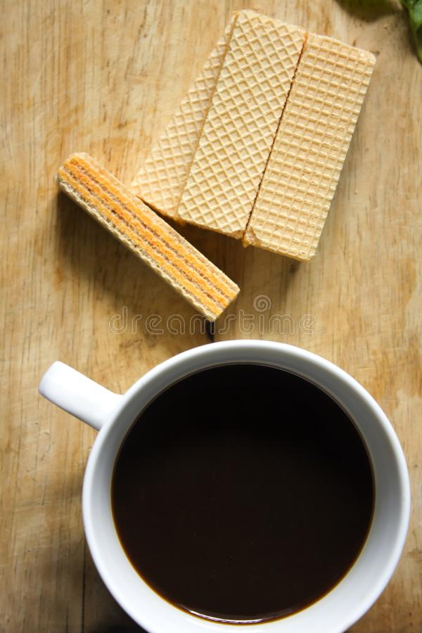 Black coffee in white glass and Wafer royalty free stock photo