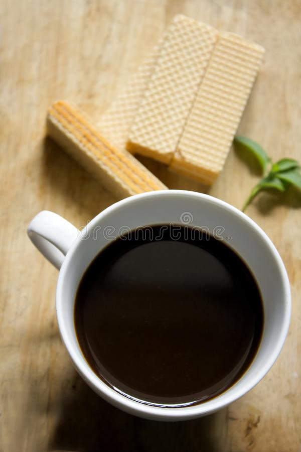Black coffee in white glass and Wafer stock images