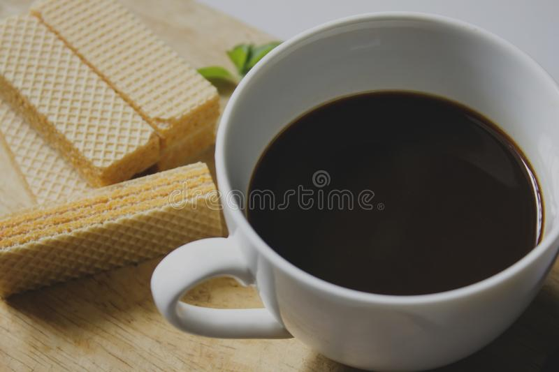 Black coffee in white glass and Wafer royalty free stock photography