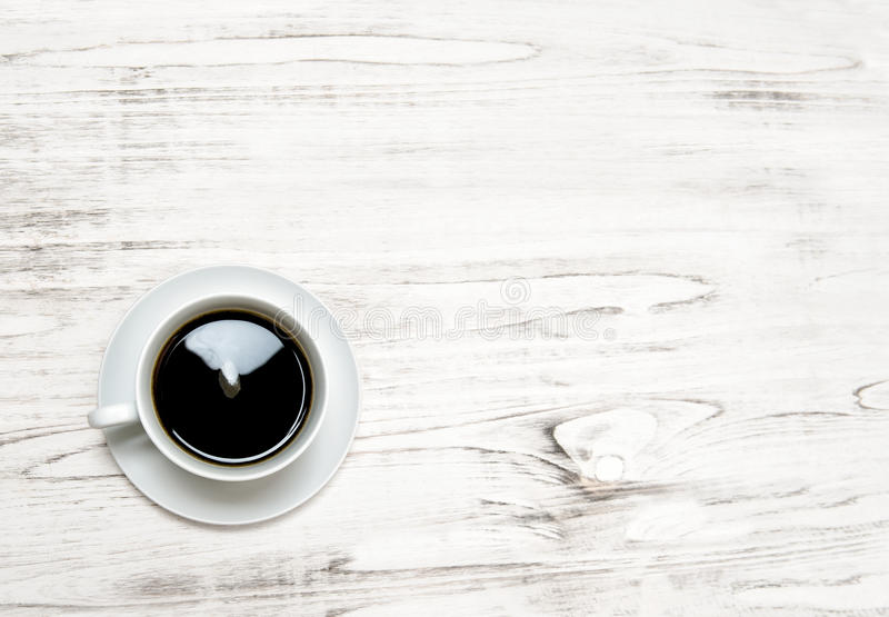 Black coffee on wooden background. Kitchen table surface royalty free stock images