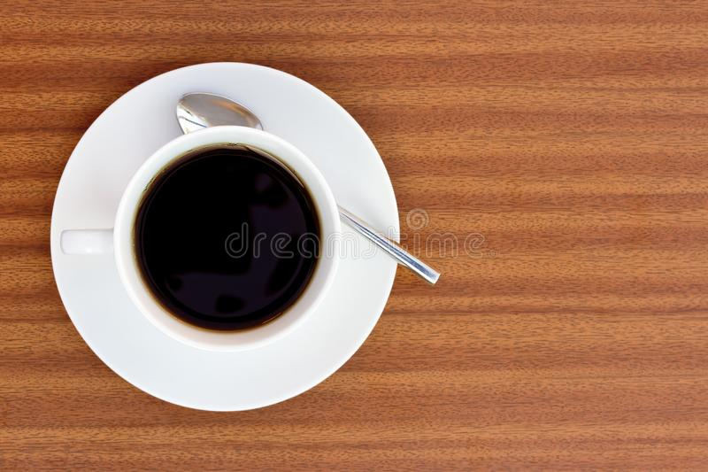 Black coffee on wooden table stock photos