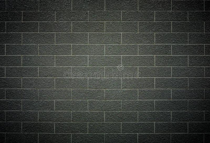 Brick wall pattern with dark grey color. royalty free stock photography