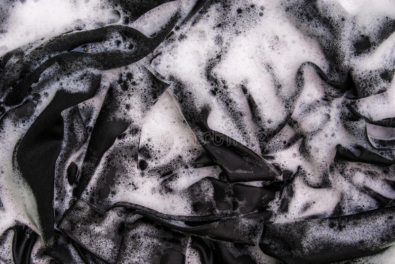 Washing black clothes royalty free stock photography