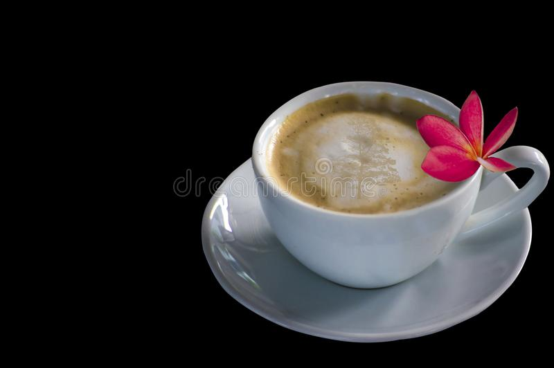 Cappuccino coffee, white glass, plumeria flowers on black backgr. Black Color, Tone Concepts and Relaxation stock photos