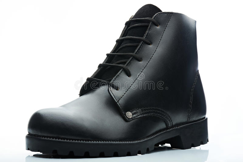 Black combat boot. Black leather men combat boot on white background royalty free stock image