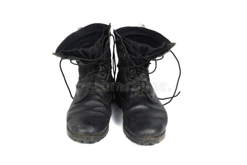 Black combat men boot, isolated on white background. Black combat men boot, black Military boots at Through use, isolated with soft shadow on white background royalty free stock photography