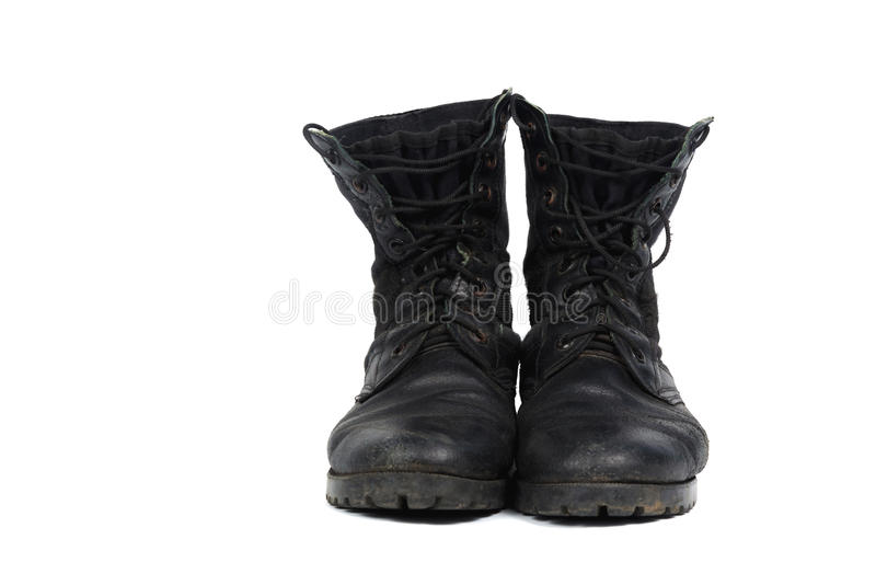 Black combat men boot, isolated on white background. Black combat men boot, black Military boots at Through use, isolated with soft shadow on white background royalty free stock photo