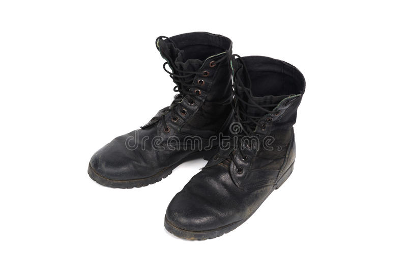 Black combat men boot, isolated on white background. Black combat men boot, black Military boots at Through use, isolated with soft shadow on white background stock images