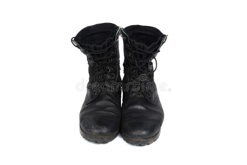 Black combat men boot, isolated on white background. Black combat men boot, black Military boots at Through use, isolated with soft shadow on white background stock image