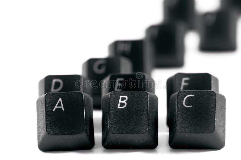 Black computer keys. Black plastic computer keys with shallow depth of field royalty free stock photos