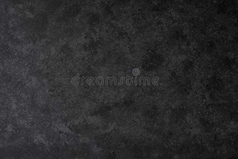 Black concrete wall. For a background stock image