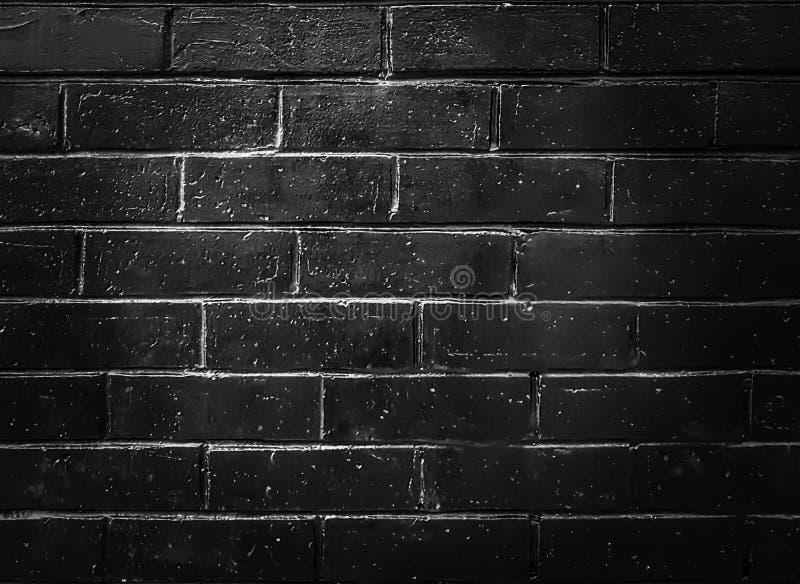 Black concrete wall, brick pattern background, stage backdrop with spotlight. Black concrete brick pattern wall backdrop background spotlight grunge rough stock photos