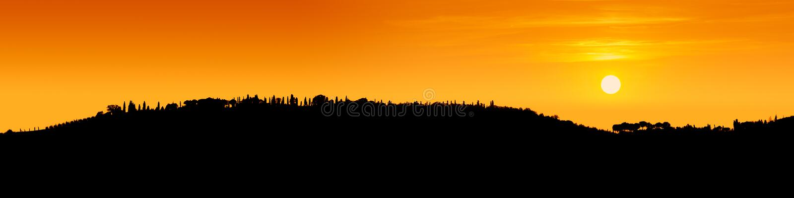 Black contour of the Tuscan hills seen under the light royalty free stock images