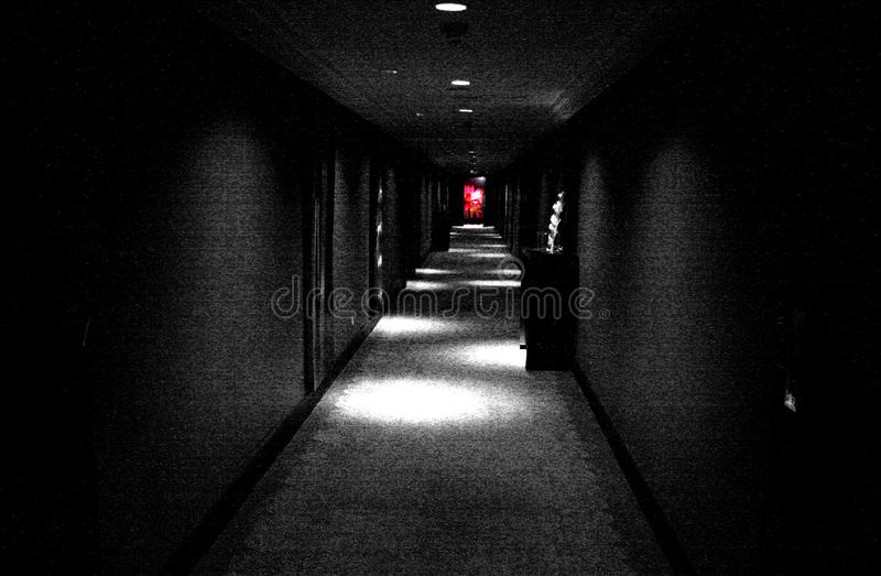 Black corridor. Red light at the end of the corridor in Banyan Tree hotel in Bangkok in Thailand by night royalty free stock photography