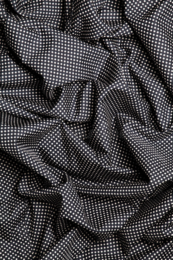 Black cotton fabric with white dots design texture. Overlapping strips. Background. royalty free stock photo