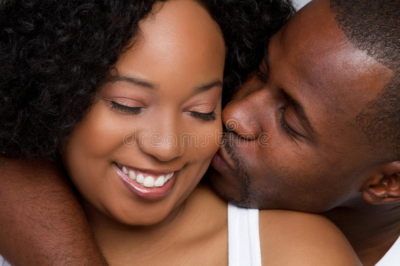 Black Couple. Happy romantic black couple smiling