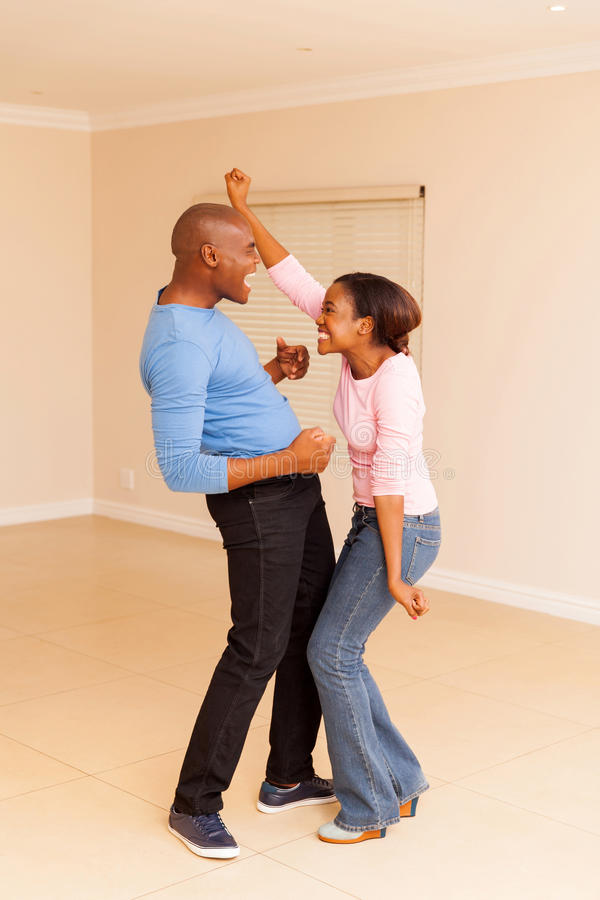 Black couple dancing home royalty free stock image